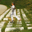 Girl in white jumping on computer keyboard monument — Stok Fotoğraf #28894507