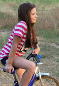 Portrait of a teenage girl on a bicycle — Stock Photo