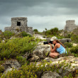 Woman photographing Caribbean coast before the rain against the — Stock Photo