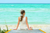 A girl in a white dreams on the pier — Stock Photo