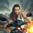 Emotional portrait of young beautiful woman on a motorbike on th — Foto de Stock