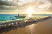 Beautiful tropical sunset with a boat on the Philippine island o — Stock Photo
