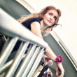 Portrait of thinking beautiful woman standing on the stairs — 图库照片