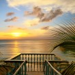 The view from the terraces of the beautiful sunset on the beach. — Stock Photo #29912095