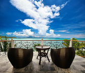 Terrace lounge with rattan armchairs and seaview. — Stock Photo