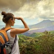 Woman traveler looking at Batur volcano. Indonesia — Stock Photo