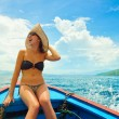 Happy woman sailing in boat on her summer holidays. — Stock Photo #46796995