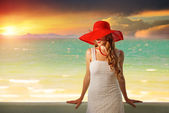 Beautiful romantic model in red hat with red lips looking at cam — Stock Photo