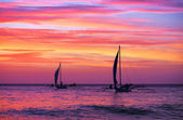 Two sailing boat in the beautiful sunset — Stock Photo