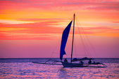 Sailing boat in the beautiful sunset. — Stock Photo