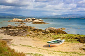 Boat at Sinas beach — Stock Photo