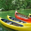 Four plastic canoes — Stock Photo #15417697