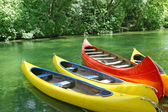 Four plastic canoes — Foto de Stock