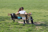 Young couple on bench — Stock Photo