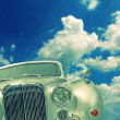 Stock Photo: Old car and clouds