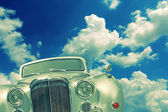 Old car and clouds — Stock Photo