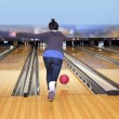 Stock Photo: Young girl playing bowling