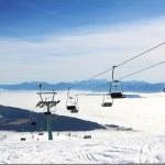 Ski lift and skiers — Stock Photo #38585051