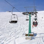 Ski lift and skiers — Stock Photo #38585515