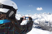Photographing mountains with use phone — Stock Photo
