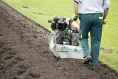 Man with rototiller — Stockfoto