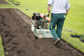 Man rototilling the ground  — Photo