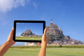 Taking pictures on a tablet — Stock Photo
