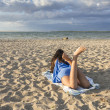 Young Girl on a sandy beach — Stock Photo #51103907