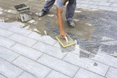 Grouting tiles on the floor — Foto Stock