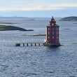 Lighthouse Kjeungskjær, near Trondheimsfjorden, Norway - Stock Photo