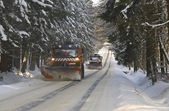 Snow plows on winter road — Stock Photo