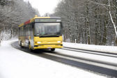 Bus on winter road — Stock Photo