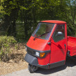 Stock Photo: Red three wheeler pickup