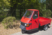 Red three wheeler pickup — Stock Photo