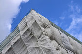Building site covered in gray tarpaulin — Stok fotoğraf
