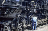 Steam locomotive, mechanic checking engine — Stock fotografie