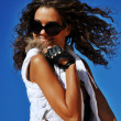 Girl in sunglasses smiling — Stock Photo #12147001