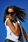 Girl in sunglasses smiling — Stock Photo
