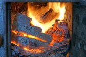 Old fireplace, stove, fire — Stock Photo