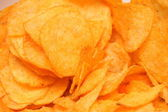 Crunchy golden chips background — Stock Photo