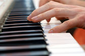 Hands pianist playing music on the piano, hands and piano player, keyboard — Stock Photo