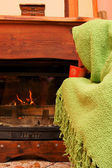 Man warms up by the fire / fireplace — Stock Photo