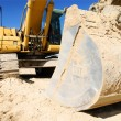 Yellow excavator, digger on blue sky — Stock Photo #13619658