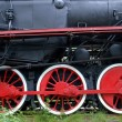 Red wheels of old locomotive, trains powered by steam — Stock fotografie