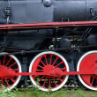 Red wheels of old locomotive, trains powered by steam — ストック写真