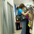 Two women shopping clothes in shop — Stok fotoğraf