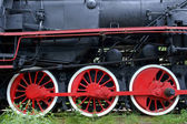 Red wheels of old locomotive, trains powered by steam — Stock Photo