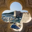 Dubrovnik, port, old fortress and the old town - Stock Photo