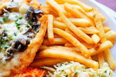 Chicken steak with fries with chips and salad — Stock Photo