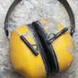 Ear protection factory noise muffs Yellow - Stock Photo